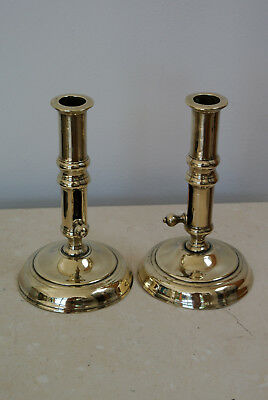 Pair 18th century seamed brass side ejector push up candlesticks C118