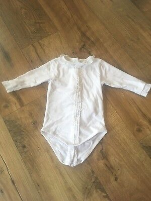 White Ruffled Long Sleeved Baby Grow 6-9 Month