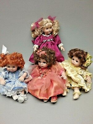 Lot of 4 Marie Osmond doll tiny tots Yellow rose of Texas Quite a Pair plus 2