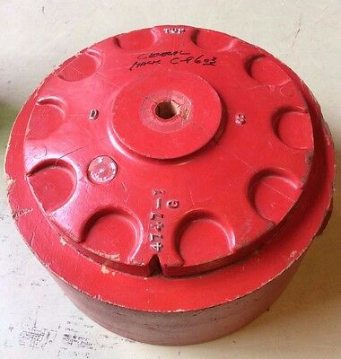 large vintage red circular wood foundry mold