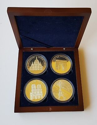 set of 4 COLLECTIBLE french coins with iconic people and places in wood box
