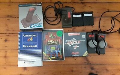 Commodore 64 Bundle, Boxed Joystick, Games And Manual.
