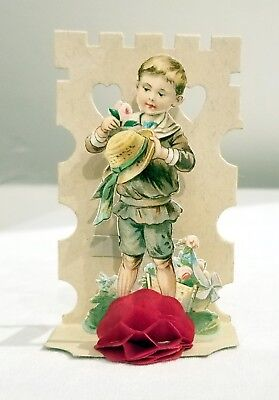 Little Boy placing Rose on his Straw Hat. Miniature Three-dimensional. Germany