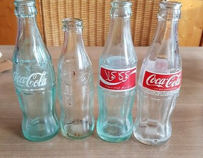 nice coca cola glass bottles ACL. 4 empty bottles
