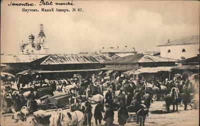 Russia Yakutsk Open market with people,oxcarts and an onion dome in the backgrou