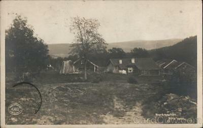 Norway Lyse A homestead with several buildings on a plot of land overlooking a m