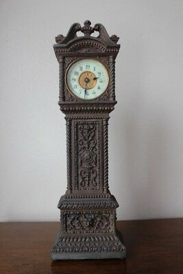 Antique cast iron Victorian Lion mascaron clock in the shape of a long case