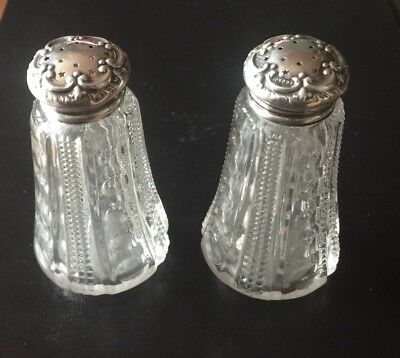 Pair Of Condiment Shakers Eith Repousse Silver Tops Chester 1902.