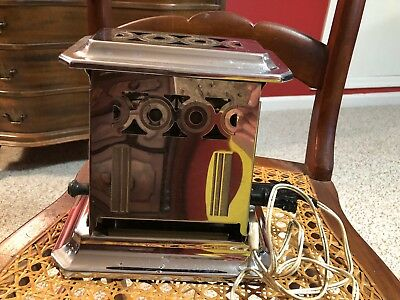 Vintage stainless steel working toaster with original decorative cord