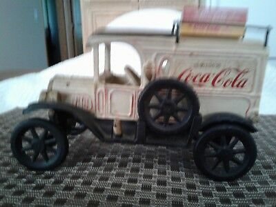 Coca Cola cast iron truck, with spare tire and coke crates