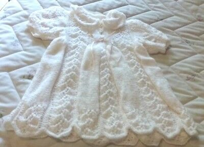 Hand knitted baby's dress - pale pink