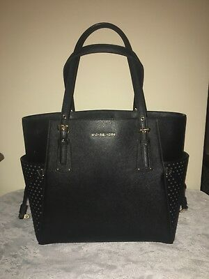 351d8feccfee Michael Kors Used black/gold east/west voyager tote saffiano leather $228