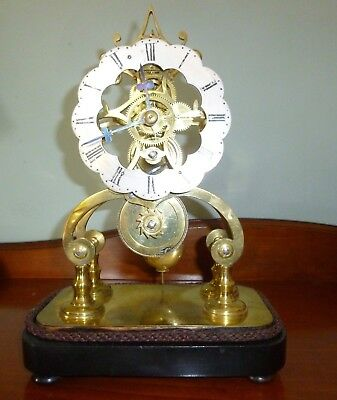 A  FINE SKELETON CLOCK ONLY 28cmHIGH AND 20cm LONG IN GOOD WORKING ORDER NO DOME