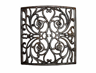 antique curved iron heat grate