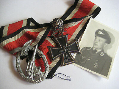 Group German WW II knight cross and oak leaves swords 900 21 + heavy gun badge