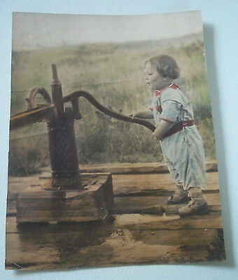 Vintage very old large hand colored photo of child at  well water pump