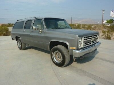 1987 Chevrolet Suburban  1987 CHEVROLET SUBURBAN 4X4 ONE OWNER 94000 MILES XINT REAR AIR 3 ROWS OF SEATS