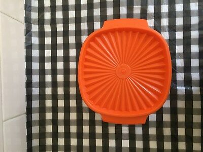 Tupperware orange bowl/ container with lid, used