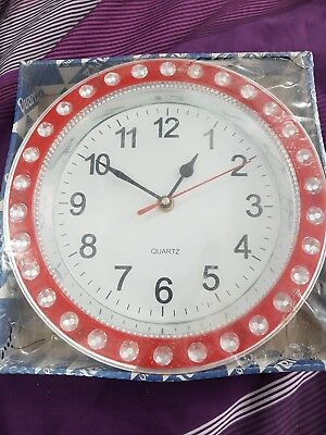 Wall clock red and silver circle design