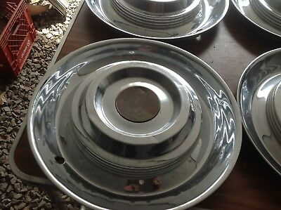1954 to 1955 Cadillac hubcaps set of four
