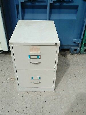 Two draw metal filing cabinet,Lockable with key.Used item. 24.5D x 18.5W x 28H
