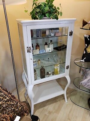 early 1920's Apothecary medical cabinet stocked with supplies