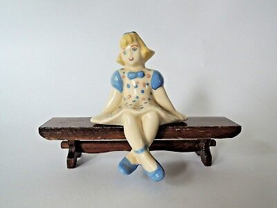 Ceramic Arts Studio Mid-Century Modern Pottery Shelf Figure of a Seated Girl
