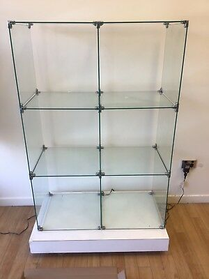 Shelving glass adjustable shelves there are 3 with app 50 pieces of glass