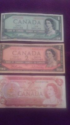 A Couple $2 and a $1 Canadian Note