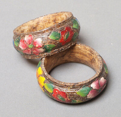 Two carved and painted KNAPKIN or SERVIETTE RINGS