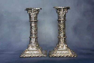ornate silver plated candlesticks mascarons masks green man renaissance motifs