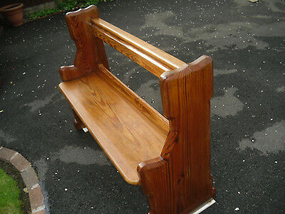 small refurbished church pew/bench in solid pitch pine timber in good condition.