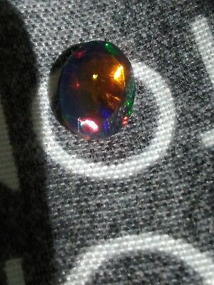 Loose black faceted opal pgtl cirtified report comes with 1.34cts  multi colour