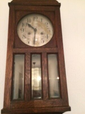 antique grandmother clock with chimes in full working order.