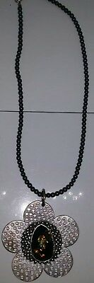 Vintage style glass beaded necklace with a large silver tone stone set pendant.