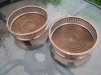 Antique Pair of Silver Plated Coasters with Wood bases for Wine or Decanters.