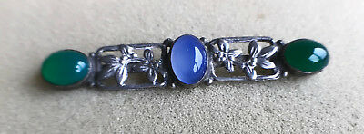 Solid silver brooch set with 2 green and 1 bluue stone
