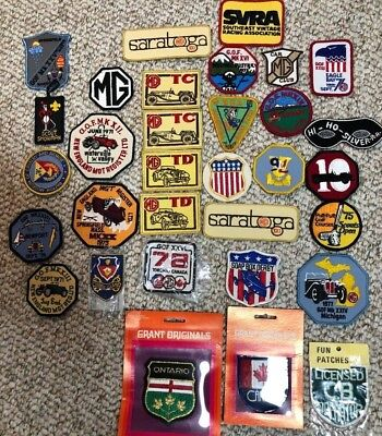 VINTAGE LOT OF 32 70's & 80's car/travel logo patches MG T Register/GOF