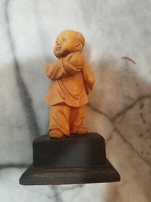 Old Wooden Carved Asian Man