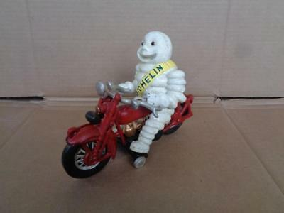 Cast Iron Harley Davidson Michelin Man On Motorcycle Glass Eyes Toy
