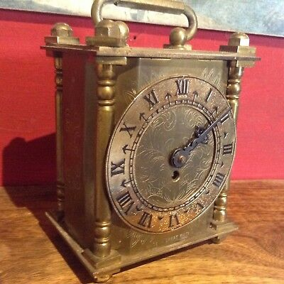 Antique Brass clock(smiths 8day needs key)beautifully engraved.