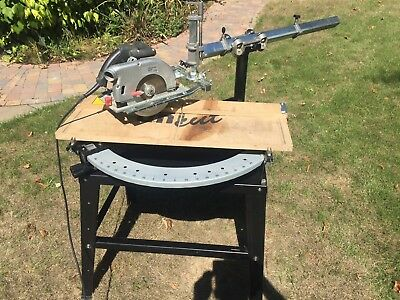 Unicut mitre saw holder table with top rail and full adjustment