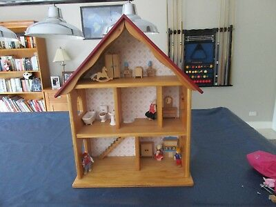 Dolls house wooden, 800mm tall and 670mm wide, includes doll furniture.
