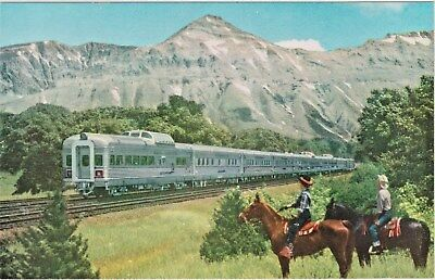Couple on Horseback views the Denver Zephyr Streamliner Passenger Train in Route