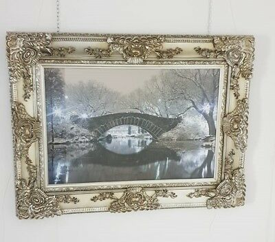 Ornate Framed Winter Scene Of A Bridge Over River Bank Enhanced With Liquid Art