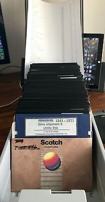 100 Commodore 64 Disks In Case w/ Games & Demos
