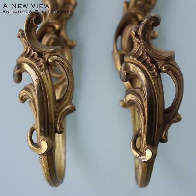 A set of two gilt bronze curtain hooks in Louis XV style, France.