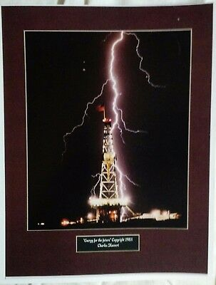 photo of oil drilling rig hit by lightning by charles keevert