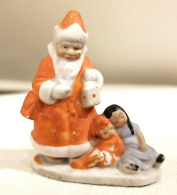 Miniature Bisque Santa holding Lantern, over Girls.  Early 1920s German Figure