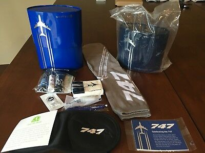 Lot of 2 - United first class amenity kit 747 commemorative - 1 new, 1 opened